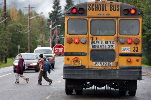 School Bus with Kids Walking Across the Road